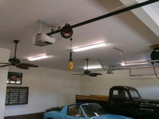 We installed shop lights and ceiling fans and outlets for garage door openers