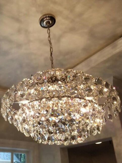 This was a chandelier we hung in the bathroom and we put LED lights behind the crown.